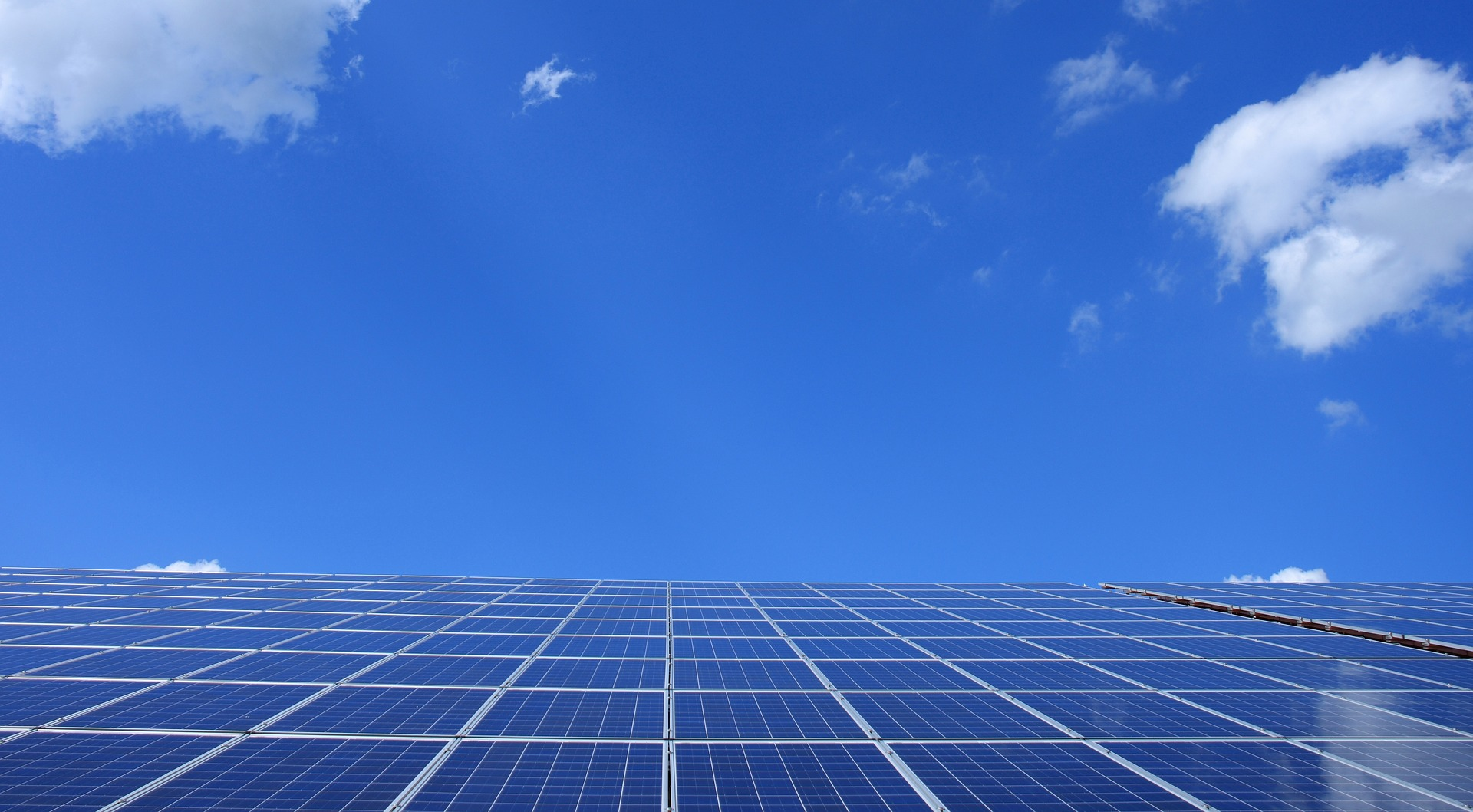 Solar panels and blue skies